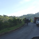 Bikers driving down the mountains loaded with goods