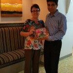 Ms Joan Musa presenting Dr Raj with a gift
