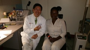 Dr Huang with a patient
