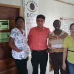 Dr Agrawal with the staff of Dangriga clinic