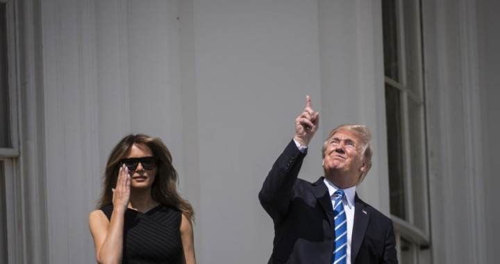 President Trump looking at the solar eclipse