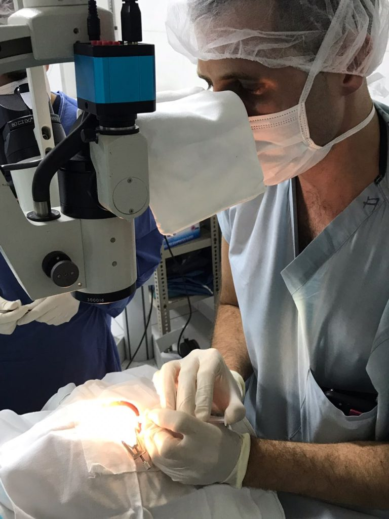 Dr. Jesse McCann injecting Avastin in a patient in the operating room.